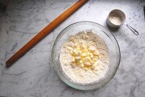 flour butter in bowl with rolling pin