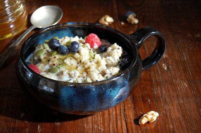 bowl of multigrain english porridge in bowl with berries