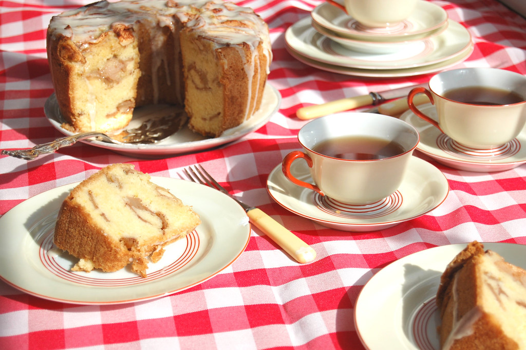 sliced Jewish Apple Cake With Tea on red checked tablecloth