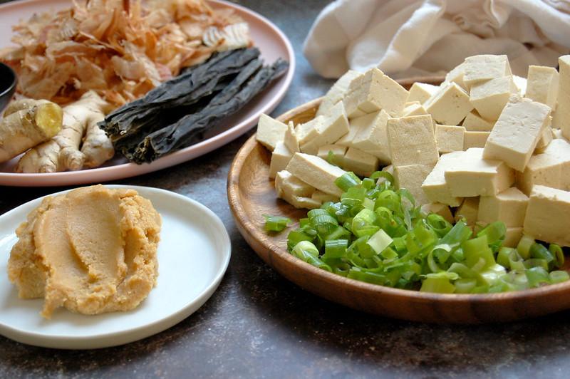 ingredients for authentic Japanese homemade miso soup recipe scallions tofu dashi bonito