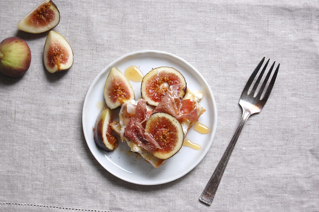 figs and honey on white plate with linen tablecloth