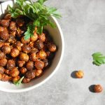 fried chickpeas in bowl with parsley