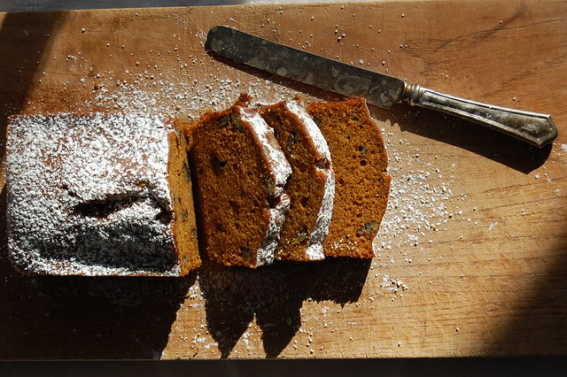 sliced pumpkin bread on cutting board with knife