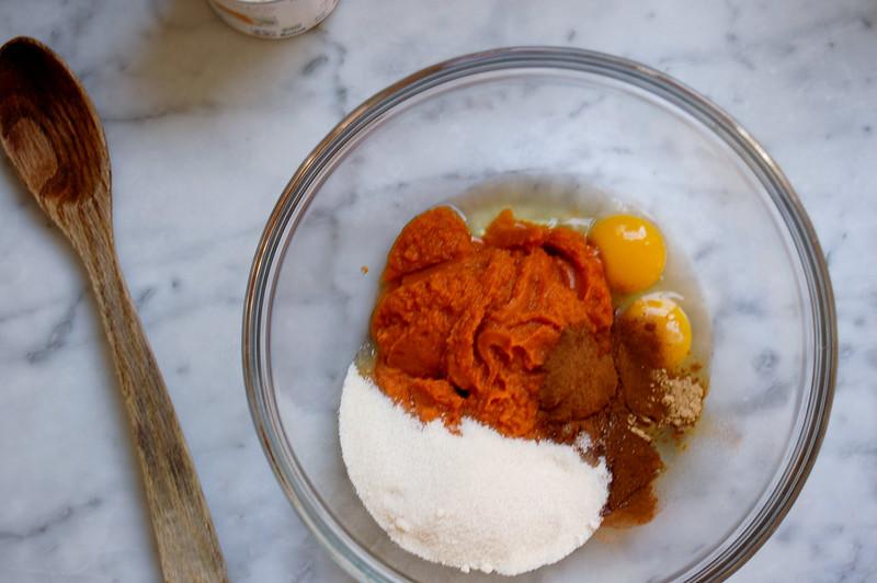 pumpkin pie ingredients in glass bowl