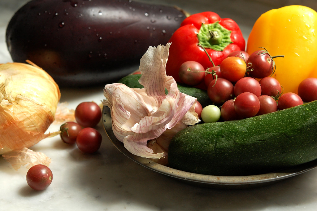 traditional ratatouille ingredients of onion, squash, eggplant, tomatoes, garlic, herbs