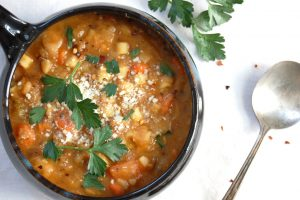 rosemary white bean soup in bowl with parsley