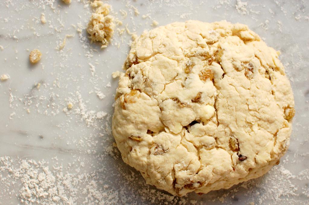 Irish soda bread dough round on marble
