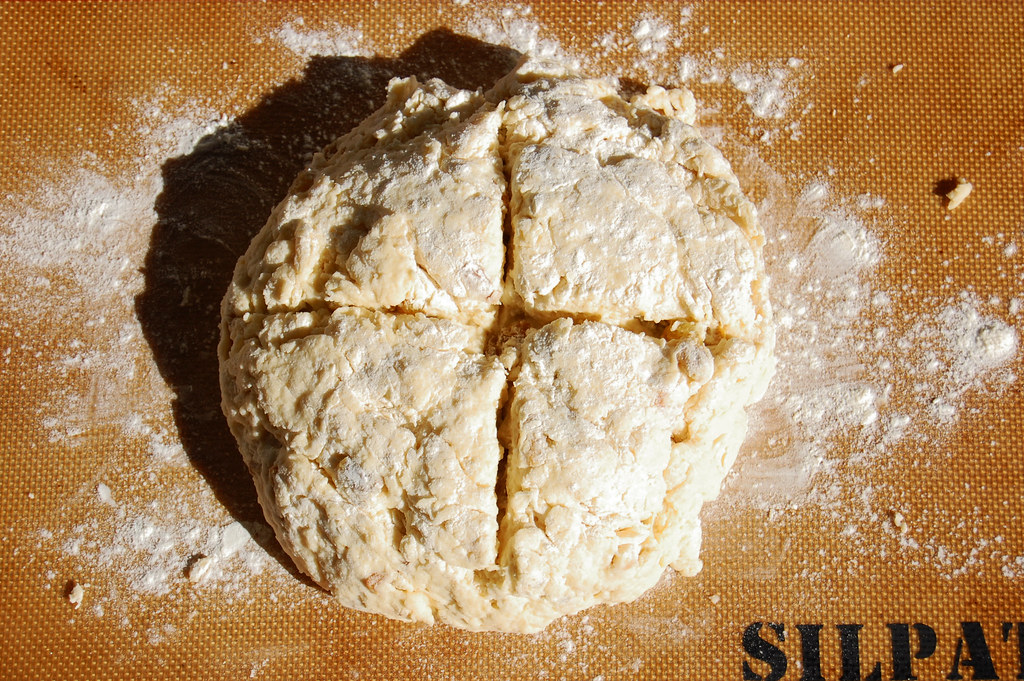 irish soda bread dough with slices to let the fairies out