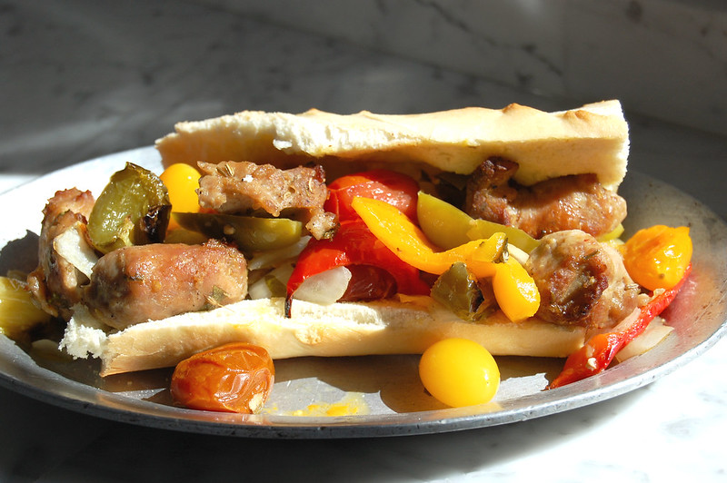 italian sausage and peppers sandwich on dish