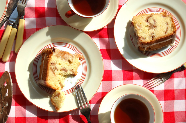 slices of Jewish Apple Cake With cups of Tea and red checkered table cloth