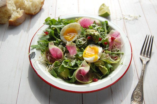 salad with watermelon radish and egg and antique fork and bread