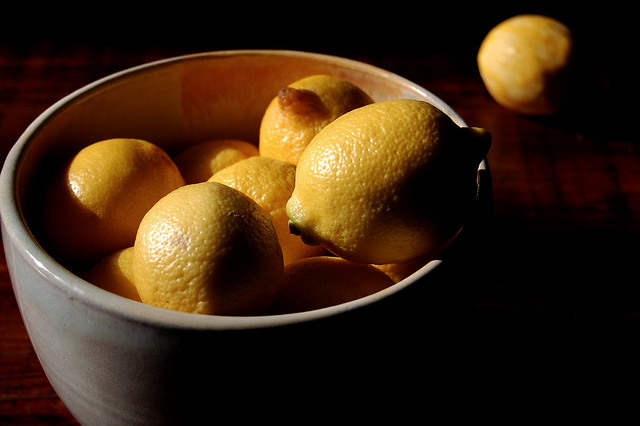 bowl of lemons in shadow food and grief writing