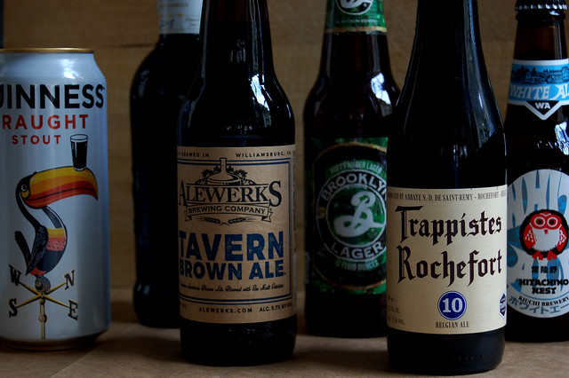 beers and stouts in bottles with wood background