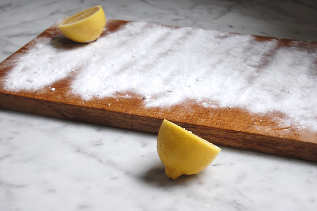 cutting board with baking soda and lemon eco-friendly green cleaning