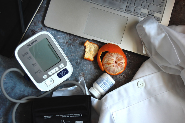 laptop with medical equipment and orange
