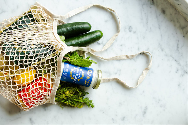 green produce in net grocery bag eco-friendly