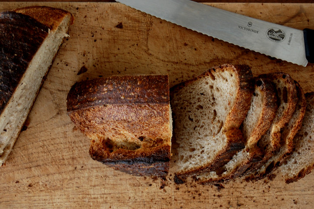sliced loaf of artisan bread on cutting board
