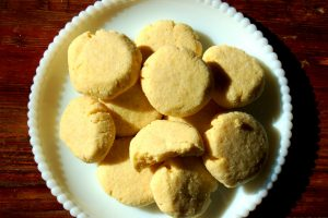 cornmeal cookies with white plate pink tablecloth