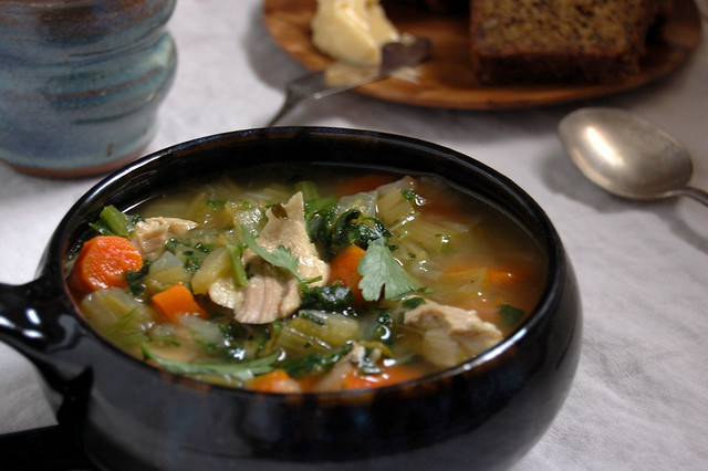 bowl of chicken soup with bread
