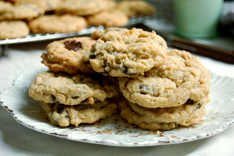 chocolate chip cookies on a plate with milk