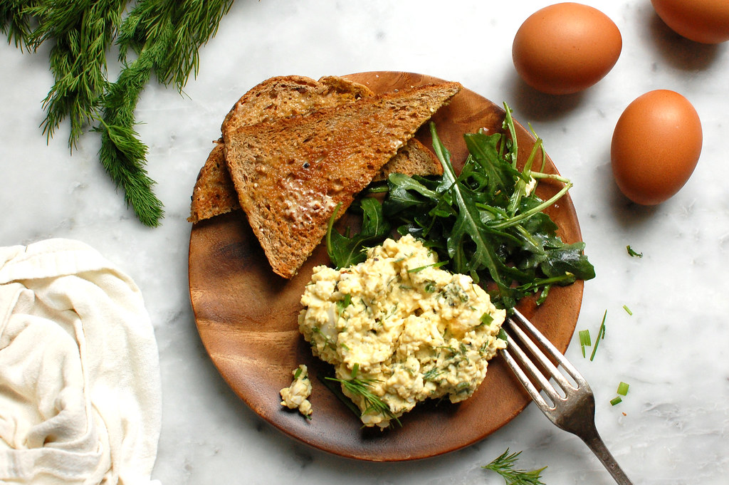 egg salad on plate with salad and fresh toast for lunch