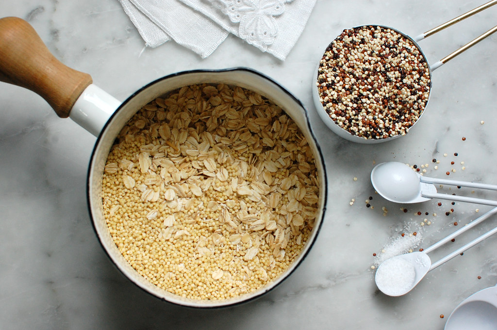raw oatmeal quinoa and millet in pot