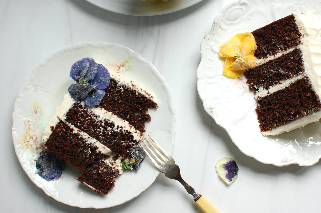 slices of chocolate cake with swiss meringue buttercream on plates