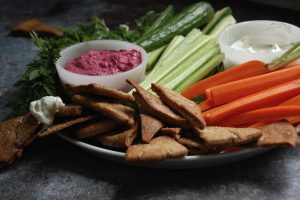 pita chips and veggies with dips