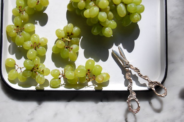 green grape clusters with scissors