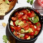 bowl of fresh salsa pico de gallo with chips