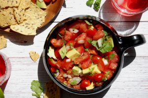 bowl of fresh salsa pico de gallo with chips