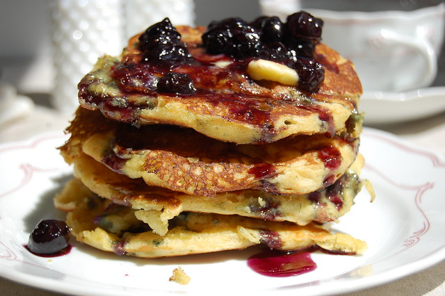 stack of buttermilk cornmeal pancakes with blueberries