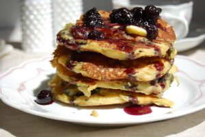stack of cornmeal pancakes with blueberries