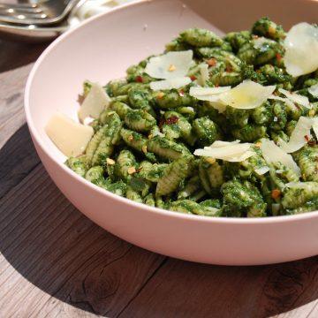 green nettle pesto pasta cavatelli in pink bowl