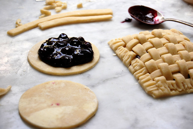 pie dough with cooked blueberry pie filling