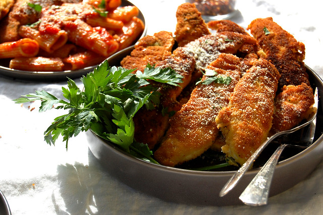 bowl of chicken tenders parsley garnish with pasta