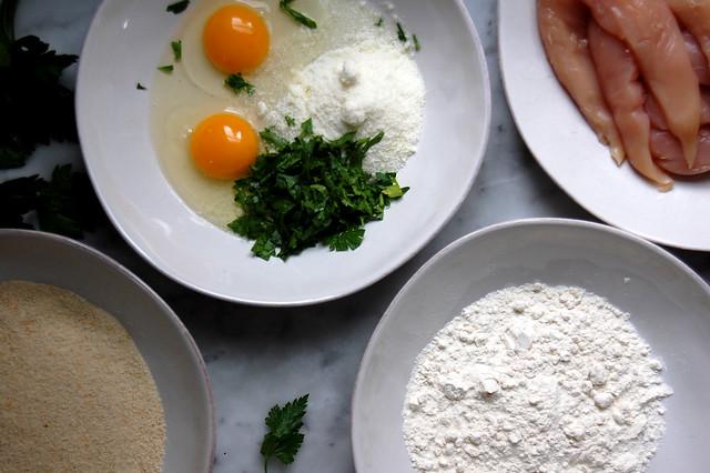 chicken tenders, egg, flour, breadcrumbs in bowls