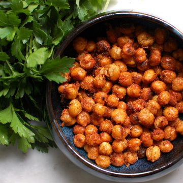 bowl of crispy roasted chickpeas in bowl with paprika