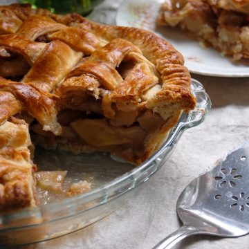 sliced apple pie in pie dish