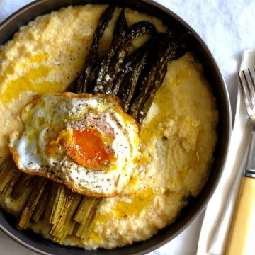 bowl of polenta with asparagus and fried egg