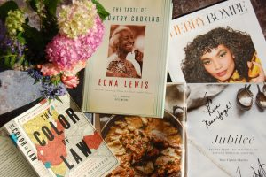 black-authored cookbooks with bouquet flowers