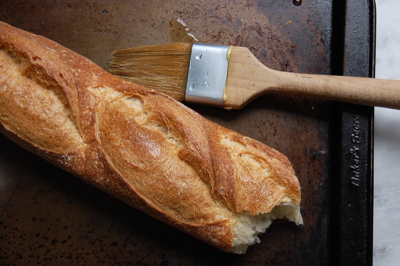 stale baguette with water on pastry brush