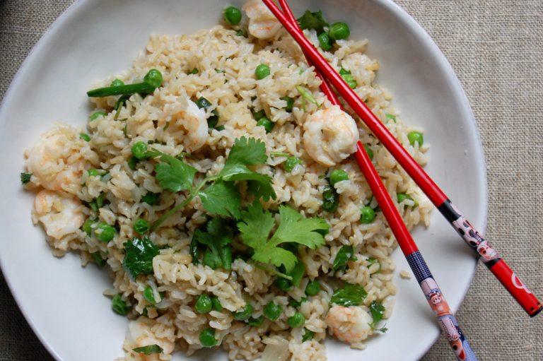 chicken shrimp fried rice with cilantro red chopsticks