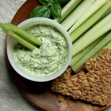 greek goddess dip on wood plate with celery and crackers