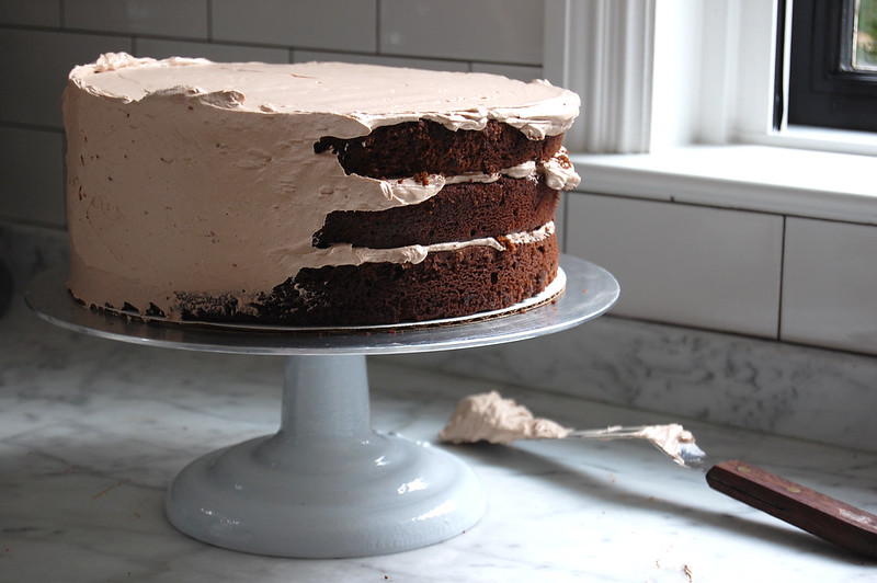 chocolate cake layers with buttercream on take turntable