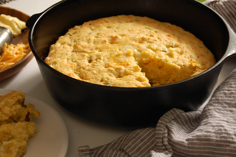 cast iron green chili cornbread with butter and cheddar cheese