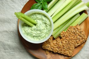 Bowl of greek goddess dip with crackers and crudite