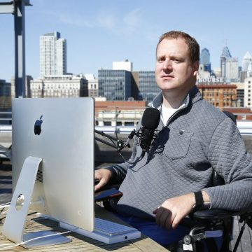 Chef Eli Kulp on roof with microphone and laptop