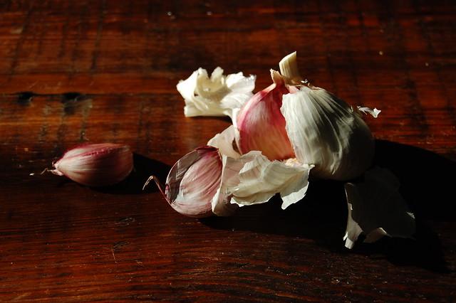 garlic on dark wood board classic italian meatballs