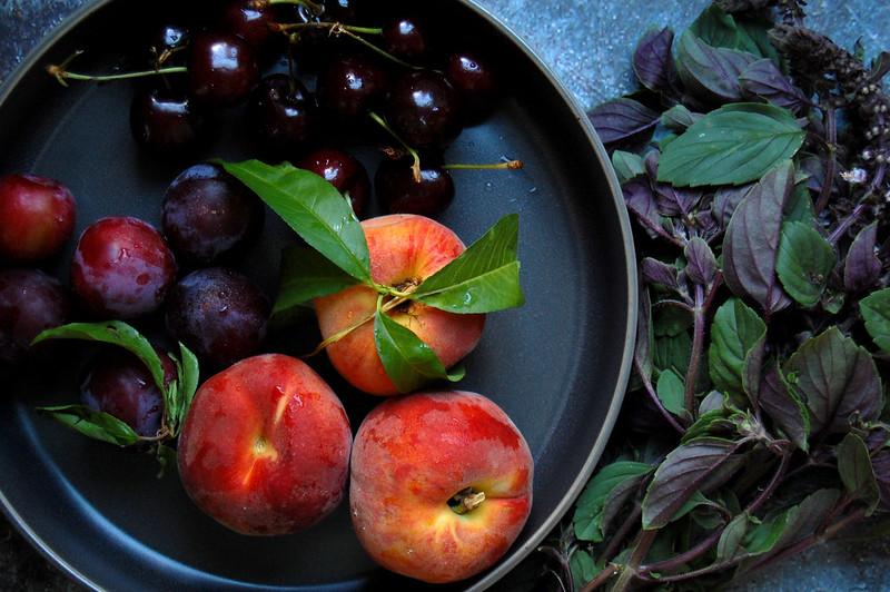 gray bowl of stone fruit for caprese burrata cherries peaches plums